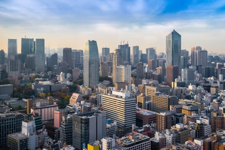 populous: Cityscapes of tokyo in Fog winter, Skyline of Tokyo, office building and downtown of tokyo in minato, Japan, Tokyo is the worlds most populous metropolis, command centers for world economy.