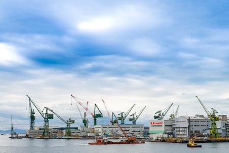 industrail: KOBE, JAPAN - NOVEMBER 23:  working crane loading bridge in shipyard at Kobe maritime port and the Hanshin Industrial Region in Kobe bay, Hyogo, Japan.