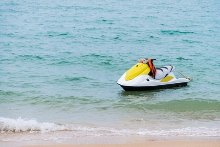 yellow and white Jet ski floating on blue sea,Tropical Ocean, pattaya city, thailand