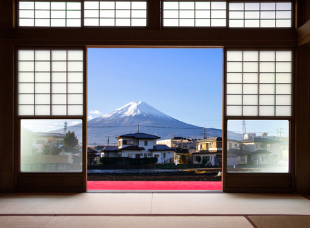 Traditional Japanese indoor  house and paper sliding doors and tatami mat open to View of a beautiful Fuji mountain and japanese house in autumn season. Kawaguchiko, Yamanashi, Japan