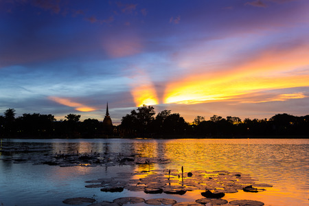 Silhouette Sunset  Sun Rise  Sky and reflection on water at Sukhothai Historical Park of Sukhothai city, Thailand Stock Photo