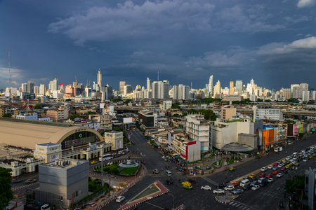 hua: cityscape Bangkok of skyline in front of railway Station (Hua Lamphong railway station) with skyscraper and modern office building background, Bangkok city, Thailand.