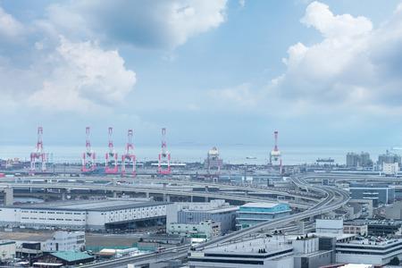 View of metropolitan expressway pass Yokohama bay, industrial and Pier Port in Yokohama, Japan