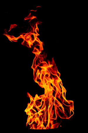 Fire flame isolated on black isolated background - Beautiful yellow, orange and red and red blaze fire flame texture style.