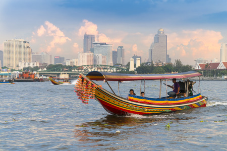 BANGKOK, THAILAND - NOV 11, 2014: Longtail Boat Tours  on the Chaophraya river and bangkok cityscape background, is favorite activities of tourists,