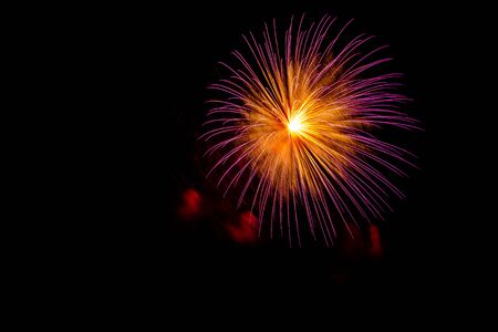 Beautiful colorful isolated firework display for celebration happy new year and merry christmas on black background