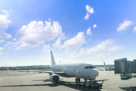 Airplane are parking in line on the runway before taking off at Dubai International Airport