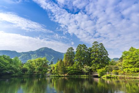 Lake Kinrin with mountain Yufu and blue sky background at Yufuin, Oita, Kyushu, Japan