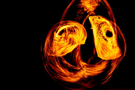 Circle of Fire flame with movment isolated on black isolated background - Beautiful yellow, orange and red and red blaze fire flame texture style. Stok Fotoğraf