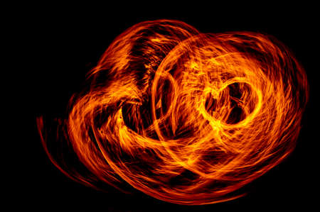 Circle of Fire flame with movment isolated on black isolated background - Beautiful yellow, orange and red and red blaze fire flame texture style. Banque d'images