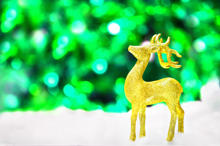 glittery: gold deer in snow on glittery background in Christmas Stock Photo