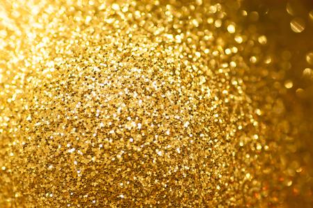 Gold-Glitter Hintergrund defokussiert abstrakt