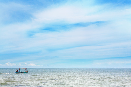 fisherman in small fisher boat on the sea Stock Photo