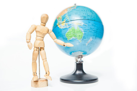 isolated wooden figure with globe on white background,welcome to australia
