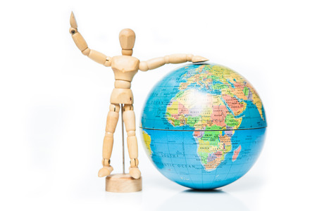 isolated wooden figure with globe on white background,welcome to africa