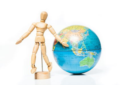 foreign bodies: isolated wooden figure with globe on white background,welcome to asia,thailand