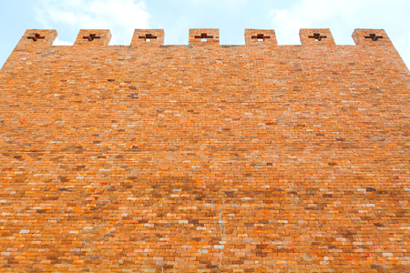 red brick wall texture on blue sky
