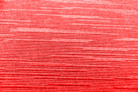 close up red corrugated paper background.