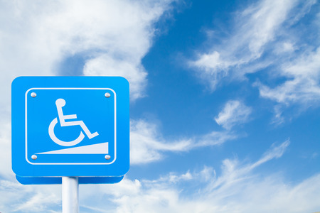 Handicap parking traffic sign on blue sky background.clipping path. copy space of your text