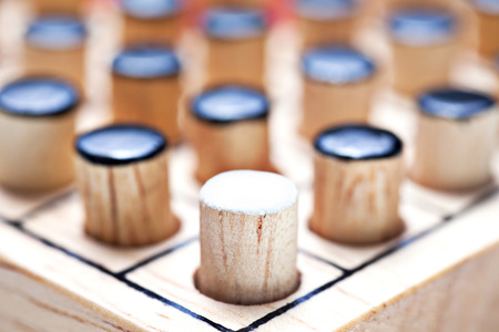 the one white in black of  Wooden Revessi Othello game close up of Different wood stick , Business concept, Selective focus
