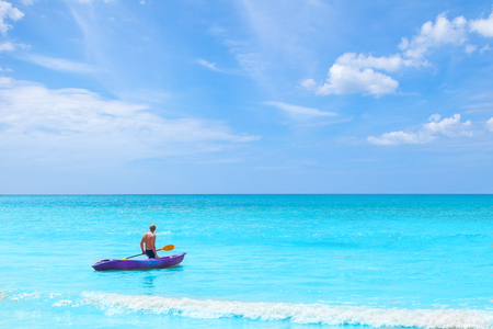 a man pulling kayak in the sea on blue sky vacation holiday summer time concepts