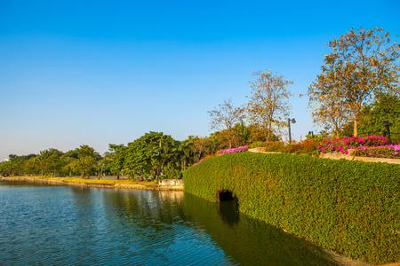 Stone Bridge in a park with lake on blue sky Standard-Bild