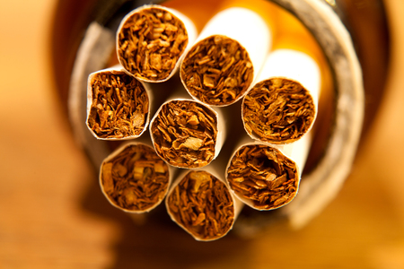 Heap of Tobacco Cigarettes, stack as a background texture close up