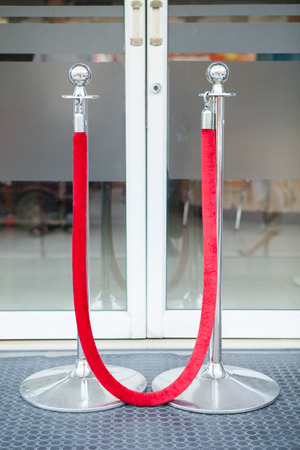 Stanchion or stand barriers in front of a door entrance Stock Photo