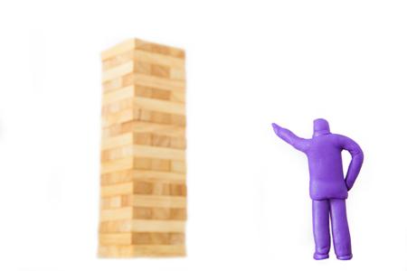 plasticine businessman commanding to blocks wood game or jenga on white background Stock Photo