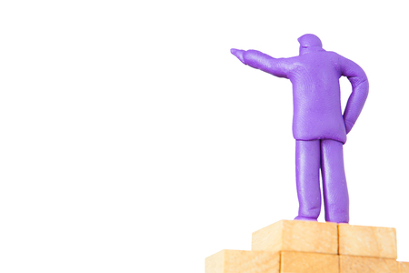 plasticine businessman commanding on wooden base on white background with clipping path Stock Photo