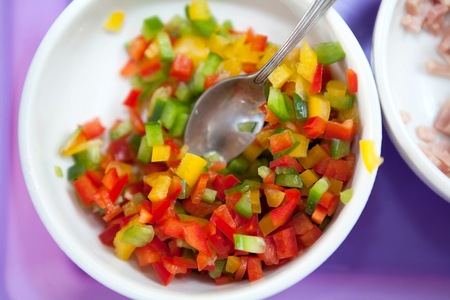 slices of green, yellow and red bell pepper Stock Photo