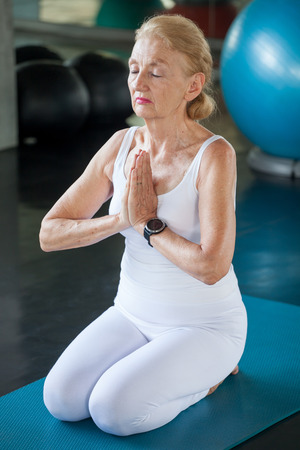 Senior woman Doing yoga in fitness gym. aged lady exercising.  Old female workout .Mature sport training.rehabilitation.elderly Healthy lifestyle concept