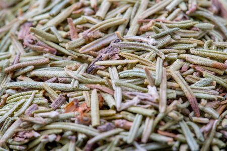 Dried Rosemary herb in black bowl close up macro