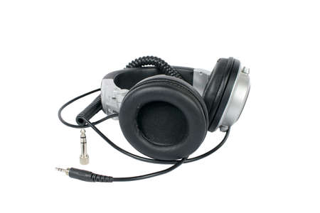 wornout: A close-up shot of worn-out, used studio headphones (studio monitors).