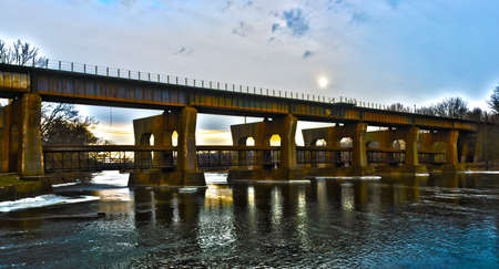 A composited shot of a rail bridge in Geneva, IL , small suburb of Chicago, using HDR.