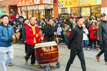 Chicago, IL, United States - February 5, 2017: Members of Chicago Dragons Athletic Association participate in Chinese New Years Parade in Chinatown, Chicago, IL.