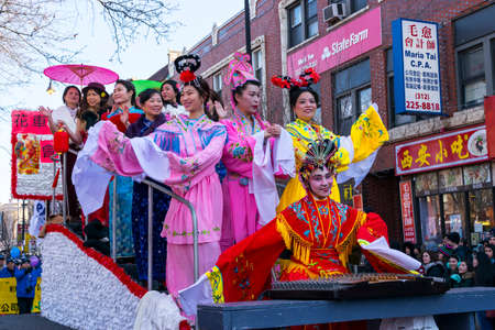 Chicago, IL, United States - February 5, 2017: Women dressed in trafitional Chinese outfits participate in Chinese New Years Parade in Chinatown in Chicago, IL.