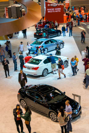 acura: Chicago, IL, United States - February 18, 2017 - Chicago Auto Show: People walking around Acuras exhibit during the 2017 Chicago Auto Show.