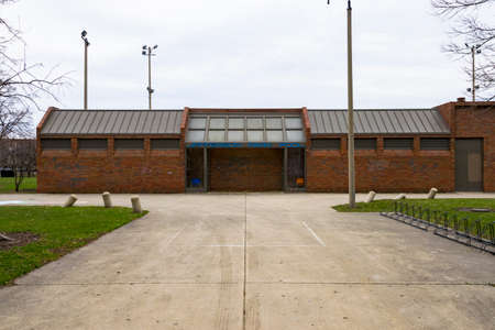 Chicago, IL, United States - March 23, 2017: A shot of Jefferson Park Pool Building. Cleaned graffiti is still visible on the buildings outer walls.
