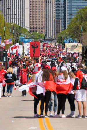 Chicago, IL, United States - May 06, 2017: People parading in Chicago during the Polish Consitution Day Parade.