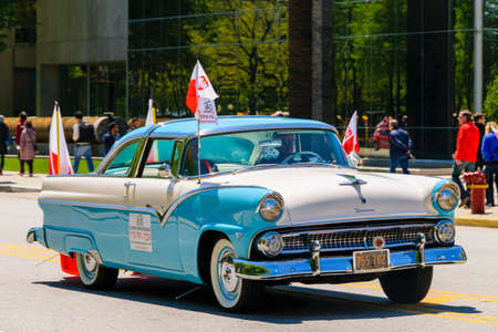 Chicago, IL, United States - May 06, 2017: Classic American car driving through The Polish Consitution Day Parade in Chicago.