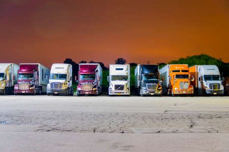 Franksville, WI, United States; August 6, 2017: Tractor-trailer trucks parked for night at a local Pilot Truck Stop in Franksville, Wisconsin, a suburb of Milwaukee, WI.