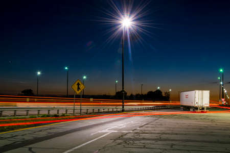 Vickery, OH, United States - September 8, 2017: Long exposure shot of a broken down truck on a ramp to Interstate 80 west-bound from one of Ohios service plazas taken during sunset. Editorial