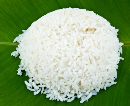 Cooked rice on banana leaf.