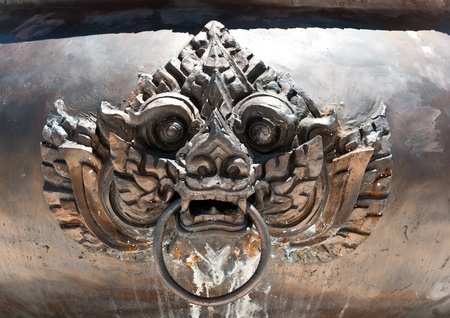 Lion head on a chinese copper censer surface.