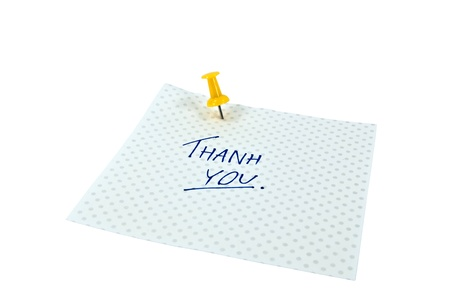 Paper note with handwritten THANK YOU words. Background is isolated. photo