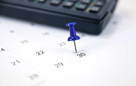 Blue Thumb Tack on Calendar.