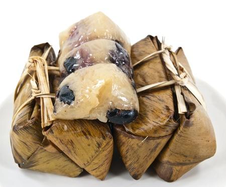 Suman (élelmiszer) Thaiföldről a rizs torta származó Fülöp-szigeteken. Ez készült nyálkás rizs főtt kókusztejjel, és gyakran párolt banán levelek. Stock fotó
