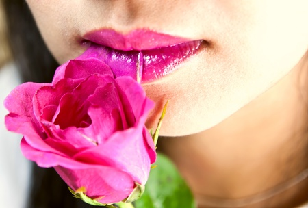 Lip of women with rose Stock Photo