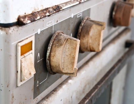 grates: Grunge gas cooker control panel. Stock Photo